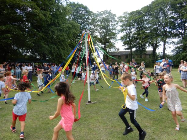 Maypole dancing at the Summer Fair
